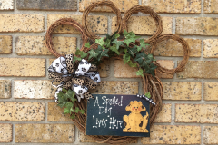 """A Spoiled Dog Lives Here Pawprint 18"""" Grapevine Wreath"""