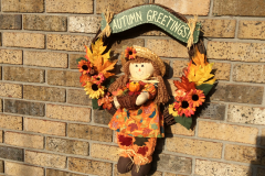 """Autumn Greetings Fall Girl With Basket 18"""" Grapevine Wreath"""