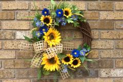 "Sunflowers, Blue Daisies + Burlap Ribbon 18"" Grapevine Wreath"