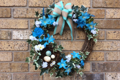 Turquoise Lilies Grapevine Wreath