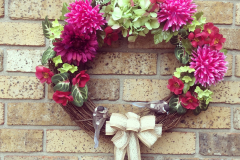 "17"" Grapevine with Fuchsia Mums, Gerbera, Green Hydrangea, Mini Red Flowers and 2 Birds."