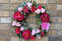 "17"" Grapevine with Fuchsia Peonies, Pink Roses, Pink Ranunculus, White Berries and Ivy."