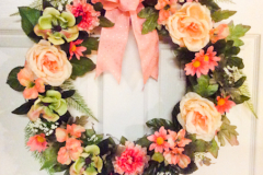 """17"""" Grapevine with Peach Roses, Green Anemones, Peach Daisies and Sprigs of Fern."""