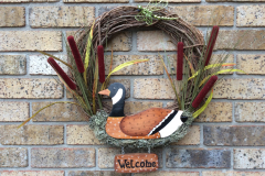 "17"" Grapevine with Wooden Duck and Welcome Sign, Bulrushes, Moss and a Dragonfly."