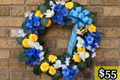 "17"" Grapevine with Blue Hydrangea, Yellow Corn Flowers, Mini White Flowers and Metal Bee. $55."