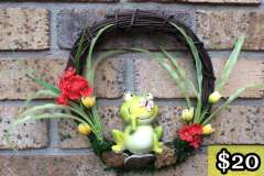 "12"" Grapevine with Ceramic Frog and Mini Red + Yellow Flowers. $20."
