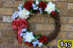 "17"" Grapevine with Deep Red Geraniums, White Gardenias, Mini White Flowers and White Sprigs. $45."
