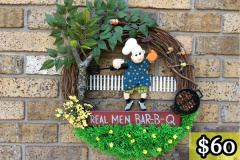 "17"" Grapevine with ""Real Men Bar-B-Q"" Sign. Wooden Man with Flipper, Meat Fork, BBQ Grill, Tree w/ Bird and Grass with Dandelions and Bees. $60."