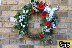 "17"" Grapevine with Large Red Roses, Wild Carrots, Ivy and White Butterflies. $55."